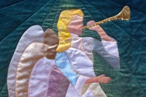photo of quilted banner of angel with trumpet