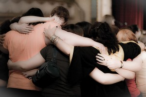 photo of a group of youth hugging