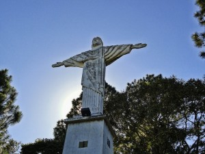 photo of a statue of Jesus with outstretched arms