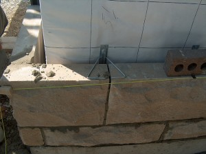 photo of the construction of a stone wall