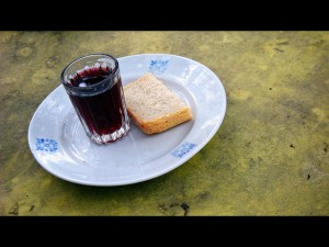 photo of slice of bread & cup of grape juice
