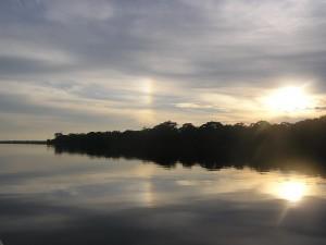 photo of sunlight on a still stream