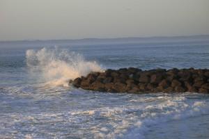 photo of surf on rocks