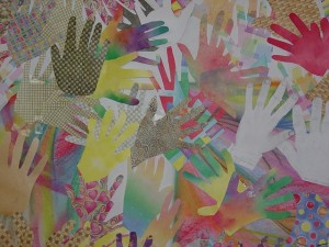 photo of banner of many hands made from cloth pieces