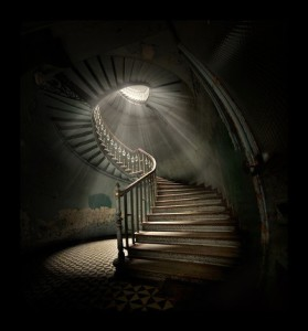winding stairs with light at the top